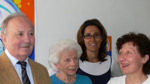 Image of Jean-Jacques Frayssinet next to three smiling women